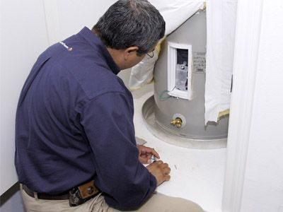 Plumbing professional from Able Plumbing Repair Service, Inc. repairing a water heater in the Orange Park, FL