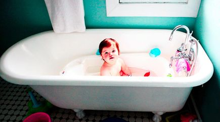Toddler taking a bath in a clawfoot tub serviced by Able Plumbing Repair Service, Inc. in Orange Park, FL